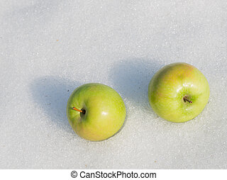 two green ripe apples - two bright green ripe apples lying...