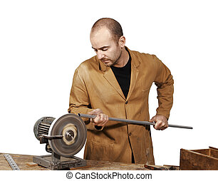 craftsman work at grinder - portrait of young caucasian...