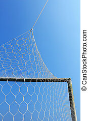 Old soccer goal with blue sky