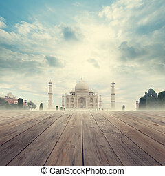 Taj Mahal India Sunrise foggy view from wooden platform