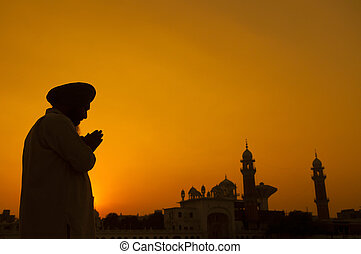 Sikh prayer - Silhouette of Sikh prayer at temple, Amritsar,...
