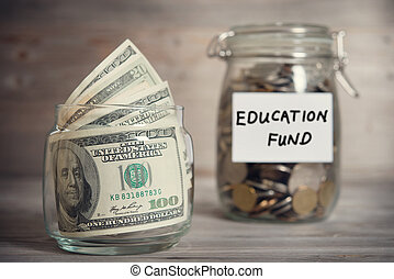 Financial concept with education fund label. - Dollars and...