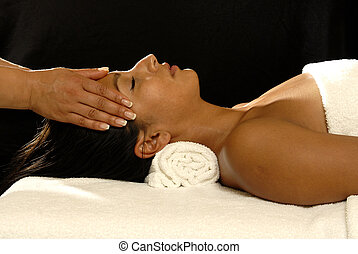 spa - woman getting head massage.