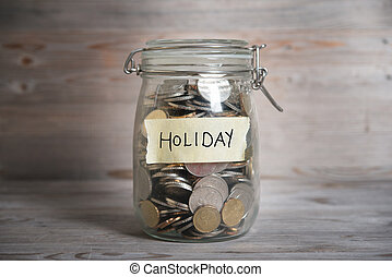 Money jar with holiday label. - Coins in glass money jar...
