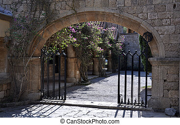 Gated entrance to Courtyard at Ialyssos Monastery Rhodes -...