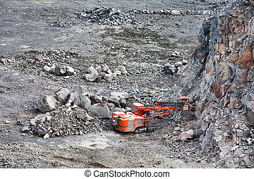 Quarry - Machinery excavating at a quarry in Harghita...
