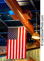 American Flag Hanging from Rafters - An American flag...
