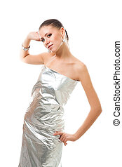 Beautiful woman in silver futuristic clothes