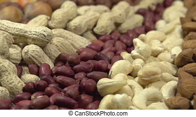 Variety of Dried Fruits and Nuts - Moving past the camera...