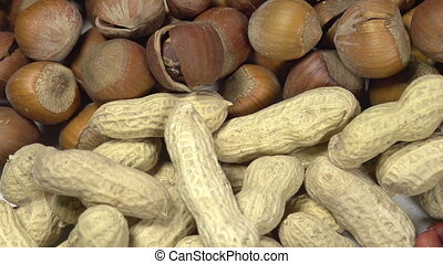 Varieties of Nuts - Moving past the camera portion of dried...