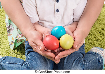 Hands holding painted easter egg