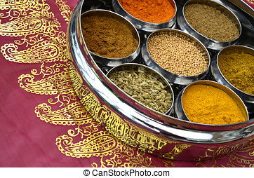 Indian Cuisine Cookery Spices in Silver Pots on a Pink and...