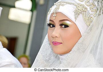 Indonesian bridal couples were undergoing the marriage...