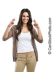 Crossing fingers - Beautiful woman crossing fingers,...