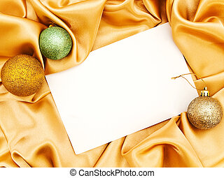 Blank Christmas invitation with decoration balls over golden...