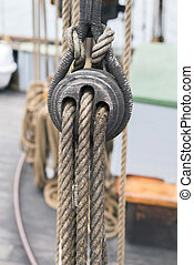 Wooden sailboat pulleys and ropes detail - Ancient wooden...