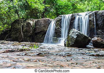 Tropical waterfall in rain forest
