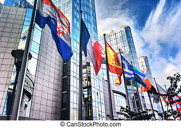 Flags in front of European Parliament building. Brussels,...
