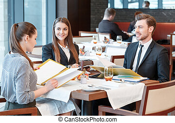 Business deals during lunch at the buffet restaurant -...