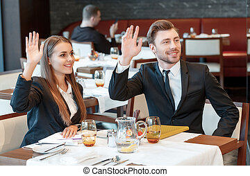 Greeting acquaintances during the business lunch - Hey...