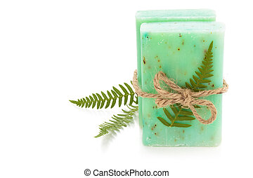 Fern soap - Green soap and fern leaves Isolated on white...