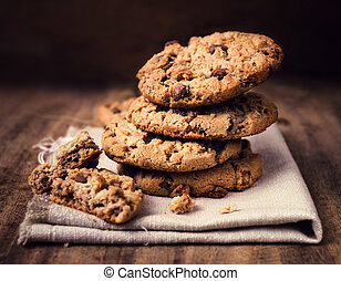 Chocolate chip cookies on linen napkin on wooden table....