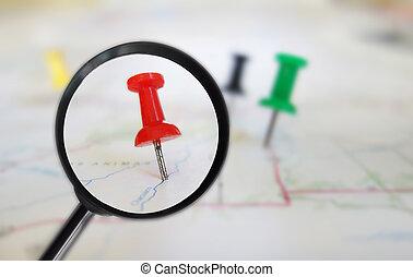 Map tacks magnified - Magnifying glass closeup of push pin...