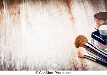 Makeup brushes and face powder with copyspace