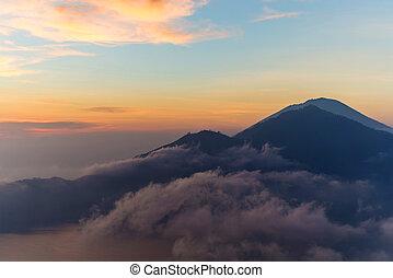 Batur - Active volcano Mount Gunung Batur at sunrise in...
