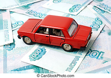 Car and money - Toy car on the background of banknotes