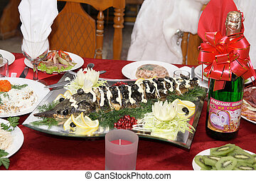 Sturgeon on a celebratory table - Decorated with vegetables...