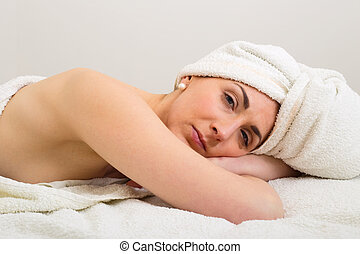young woman enjoying a spa treatment