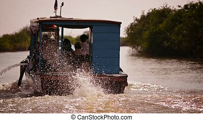 Cambodian riverboat motoring upstream - 1920x1080 video -...