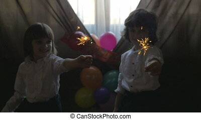 Twin sisters playing with fireworks - Young beautiful twin...