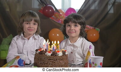 Beautiful sisters blowing candles - Young beautiful twin...