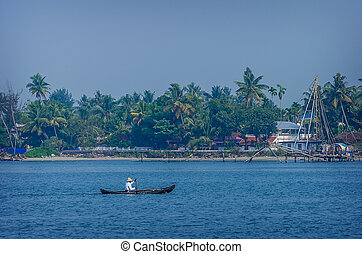 Indian fishermen at the city port Kochin, India Indian...