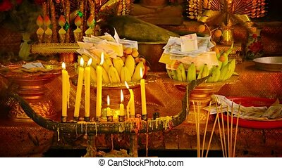 Offerings at a Religious Shrine in Cambodia - Offerings of...