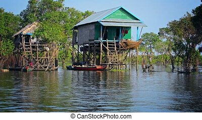 River Houses on Stilts in Cambodia - River houses on stilts...