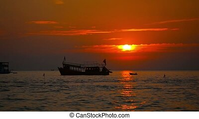 Boat at Anchor and Jetski at Sunset in Sihanoukville,...