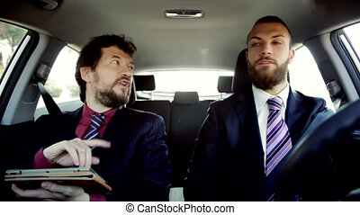 business men working in car - Happy cool handsome business...