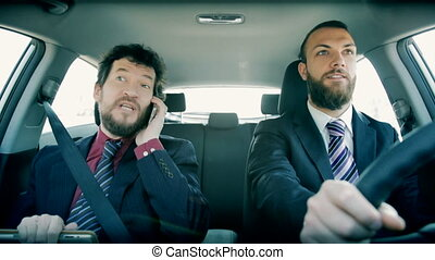 business men going to meeting - Happy men at work in car