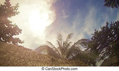 Partly Cloudy Sky Over a Thatched Roof in Sihanoukville,...