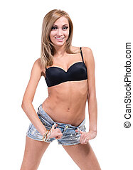 Girl in shorts jeans standing on a white background