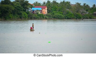Fishermen Rowing on the Stung Sen River in Cambodia