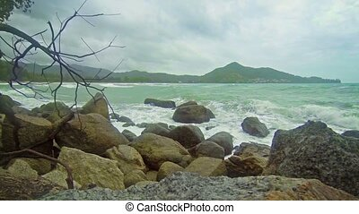 Small Waves Wash over Rocks on a Thai Beach - Video FullHD -...