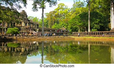 Tourists Strolling among Ancient Ruins at Angkor Wat - Video...