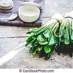 Ramson with sour cream and salt to the light board, greens,...