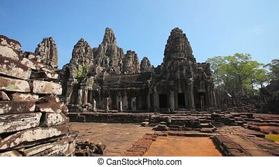 Tourists under Clear Skies at Angkor Wat