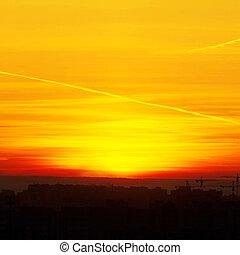 Beautiful nature background - red sunset, bright sun. Scenic...