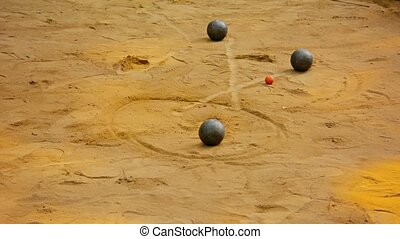 Game of Petanque on Sand in Luang Prabang, Laos